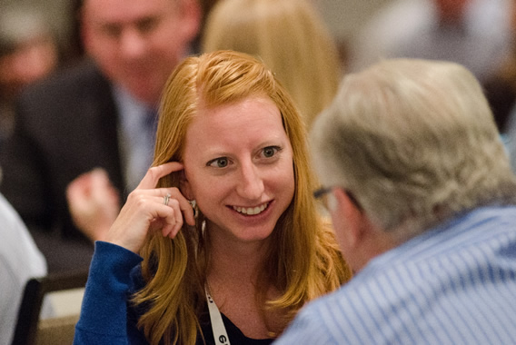 woman smiling at conference